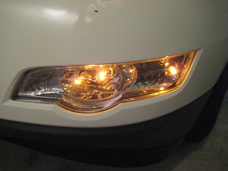 ... the headlight bulbs in a 2009-2012 GM Chevy Traverse crossover SUV