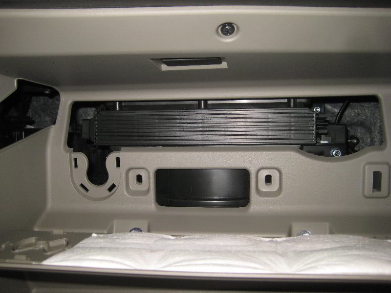 how to change air filter kia sedona 2002