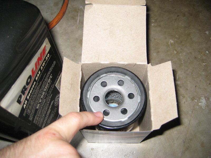 Nissan versa mr18de i4 engine oil change guide 013 for Nissan versa motor oil